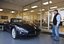 <p>A customer looks at a Maserati while browsing at Foreign Cars Italia, a Ferrari, Aston Martin and Maserati dealer in Charlotte, North Carolina, December 29, 2010. REUTERS/Chris Keane</p>