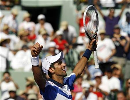 Serbia's Novak Djokovic reacts after defeating Spain's Rafael Nadal in a tiebreaker in the finals of the 2011 Sony Ericsson Open tennis tournament in Key Biscayne, Florida, April 3, 2011. REUTERS/Andrew Innerarity