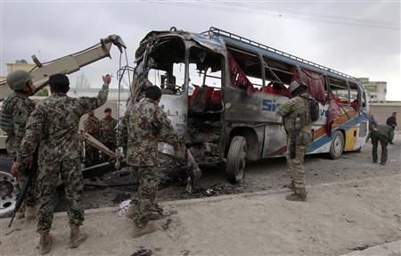 Members of the Afghan national army remove a bus destroyed from the site of a suicide attack in Kabul April 9, 2011. REUTERS/Omar Sobhani
