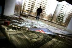 <p>Newspapers from March 1986 with a picture of Soviet state founder Vladimir Lenin are seen in an empty building in the abandoned town of Pripyat, in the 30 km (19 miles) exclusion zone around the closed Chernobyl nuclear power plant March 31, 2006. REUTERS/Damir Sagolj</p>