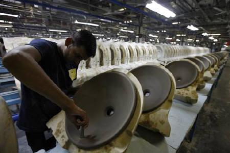 An employee works inside a production site in Gujarat in this September 21, 2010 file photo. REUTERS/Amit Dave/Files