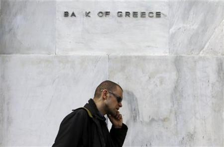 A man walks past the Bank of Greece in central Athens, April 6, 2011. REUTERS/John Kolesidis