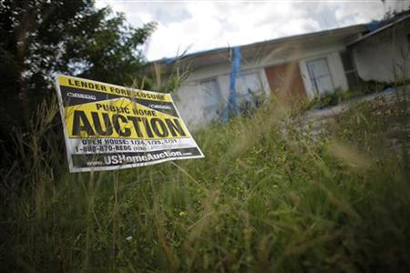 An auction sign for a Florida property in a file photo. REUTERS/Carlos Barria