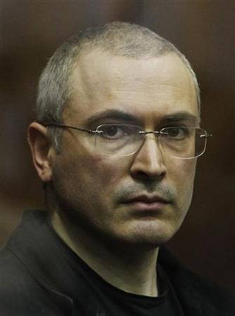 Jailed Russian former oil tycoon Mikhail Khodorkovsky stands in the defendants' cage during a court session in Moscow December 30, 2010. REUTERS/Denis Sinyakov