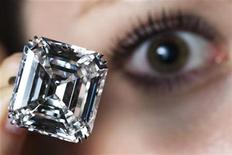 <p>A model displays an emerald-cut white diamond, set as a ring, during an auction preview at Sotheby's in Geneva May 5, 2010. REUTERS/Valentin Flauraud</p>