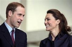 <p>Britain's Prince William speaks, watched by his fiancee Kate Middleton at the Darwen Aldridge Community Academy (DACA), in Darwen, northern England April 11, 2011. REUTERS/Adrian Dennis/Pool</p>