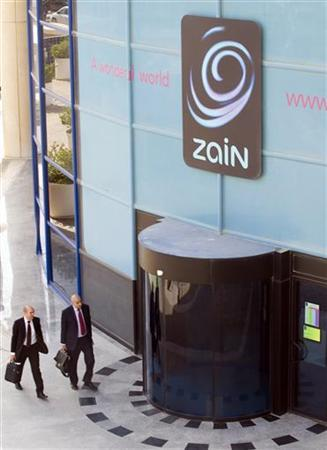 Businessmen enter the main doors of the Zain Telecommunication head office in Kuwait City October 13, 2009. REUTERS/Stephanie McGehee