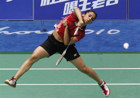 File photo of India's Saina Nehwal returns a shot against Hong Kong's Yip Pui-yin during the women's singles badminton quarterfinals at the 16th Asian Games in Guangzhou, Guangdong province November 18, 2010.    REUTERS/Bobby Yip/Files