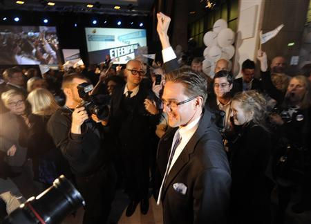 National Coalition Party chairman and Finnish Finance Minister Jyrki Katainen greets supporters as he re-enters the party's election night reception in Helsinki, Finland, after the Finnish Parliamentary Elections April 17, 2011. REUTERS/Markku Ulander/Lehtikuva