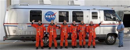 Space shuttle Endeavour STS-134 crew (from L to R) mission specialists Greg Chamitoff and Andrew Feustel; European Space Agency astronaut Roberto Vittori, mission specialist Michael Fincke, pilot Gregory Johnson, and commander Mark Kelly stand in front of the astronaut van, while departing crew quarters for launch pad 39A during the terminal countdown demonstration test at the Kennedy Space Center in Cape Canaveral, Florida April 1, 2011. REUTERS/Scott Audette
