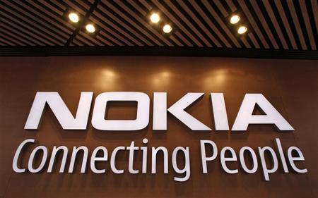 A corporate logo is displayed at the Nokia flagship store in Helsinki September 29, 2010. Picture taken September 29. REUTERS/Bob Strong