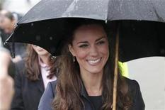 <p>The fiancee of Britain's Prince William, Kate Middleton, holds an umbrella during a visit to the Darwen Aldridge Community Academy (DACA), in Darwen, northern England April 11, 2011. REUTERS/Phil Noble</p>