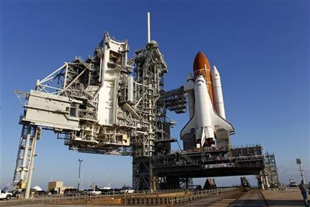 Space shuttle Endeavour sits atop launch pad 39A after arriving from the Vehicle Assembly Building to prepare for Mission STS-134 at the Kennedy Space Center in Cape Canaveral, March 11, 2011. REUTERS/Joe Skipper