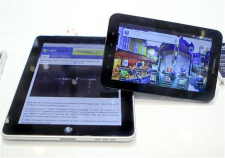 The Apple iPad (L) next to Samsung's Galaxy Tab tablet device in Berlin, September 2, 2010. REUTERS/Thomas Peter