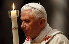 <p>Pope Benedict XVI arrives holding a candle as he leads the Easter Vigil mass in Saint Peter's Basilica in Vatican April 23, 2011. REUTERS/Alessandro Bianchi</p>