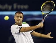 <p>Михаил Южный во время матча на турнире ATP Dubai Tennis Championships в Дубае 22 февраля 2011 года. Россиянин Михаил Южный поднялся на 13-ю строчку рейтинга ATP, обновленная версия которого была опубликована в понедельник. REUTERS/Ahmed Jadallah</p>