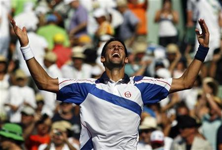 Serbia's Novak Djokovic reacts after defeating Spain's Rafael Nadal in a tiebreaker in the final of the Sony Ericsson Open tennis tournament in Key Biscayne, Florida, April 3, 2011. REUTERS/Andrew Innerarity