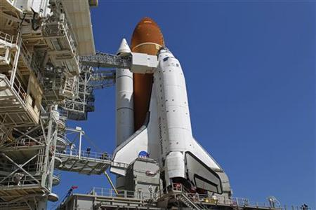 Space shuttle Endeavour sits atop launch pad 39A after arriving from the Vehicle Assembly Building to prepare for Mission STS-134 at the Kennedy Space Center in Cape Canaveral, Florida, Florida March 11, 2011. REUTERS/Joe Skipper