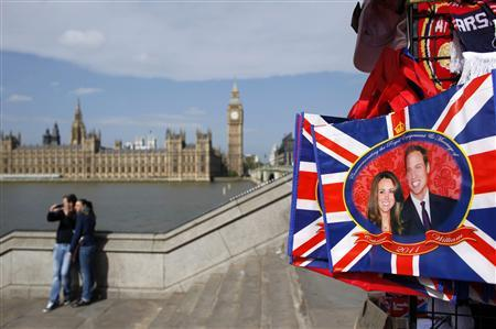An image of Prince William and his soon-to-be bride Kate Middleton is seen on a souvenir in London April 27, 2011. REUTERS/Marcelo del Pozo