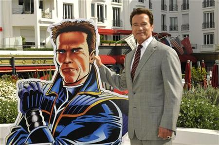 Former California Governor Arnold Schwarzenegger poses during the photocall of the animated tv series ''The Governator'' during the yearly MIPTV, the International Television Programs Market, in Cannes, southeastern France, April 4, 2011. REUTERS/Jean-Pierre Amet