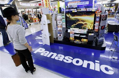 A woman looks at a Panasonic TV set at an electronics shop in Tokyo in this October 30, 2009 file photo. Japanese consumer electronics giant Panasonic Corp will slash 40,000 jobs over the next two years in a bid to pare costs and keep up with ever-tougher competition from Asian rivals, a source said on April 28, 2011. REUTERS/Kim Kyung-Hoon/Files