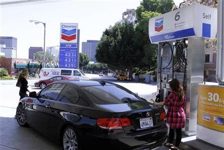 A woman fills up at a at a gas station in Los Angeles, April 11, 2011. REUTERS/Fred Prouser