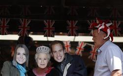 <p>People wear masks depicting Britain's Queen Elizabeth (2nd L), Kate Middleton (L) and Prince William (2nd R), in a cafe in St. James's Park in central London April 28, 2011. Prince William will marry his fiancee Kate Middleton in Westminster Abbey on April 29. REUTERS/Marcelo del Pozo</p>