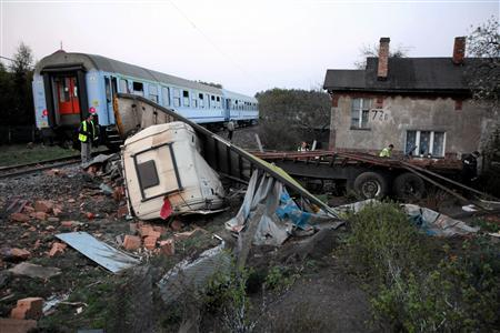 A general view of the accident site after a train derailed at a road crossing in the village of Mostki, northern Poland April 28, 2011. REUTERS/Dominik Sadowski/Agencja Gazeta