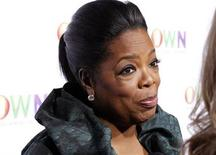 <p>Foto de archivo de la presentadora de televisión Oprah Winfrey durante el lanzamiento de su cadena OWN en Pasadena, EEUU, ene 6 2011. Winfrey realizará una fiesta de despedida en el estadio United Center de Chicago el 17 de mayo, mientras avanza la cuenta regresiva para el fin de su popular programa de televisión, dijeron el jueves sus productores. REUTERS/Fred Prouser</p>