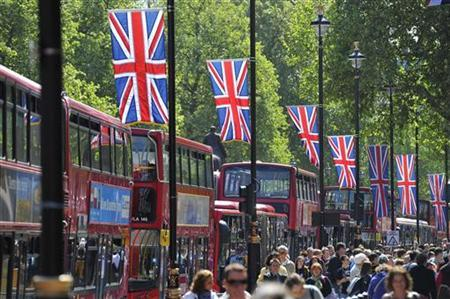 Crowds walk along Whitehall which will be part of the Royal Wedding Procession Route, in central London April 27, 2011. REUTERS/Toby Melville