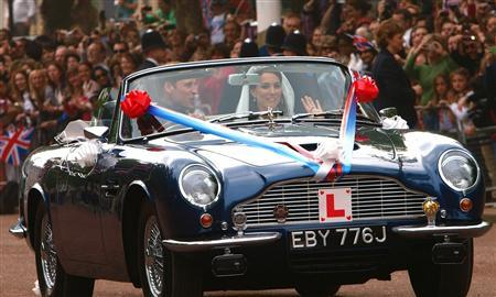 Britain's Prince William and his wife Catherine, Duchess of Cambridge drive from Buckingham Palace in an Aston Martin DB6 Mark 2, after their wedding in Westminster Abbey, in central London April 29, 2011. REUTERS/Max Nash/Pool