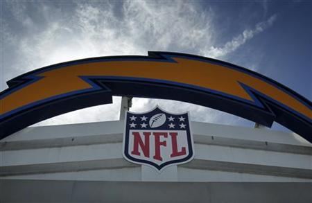 The NFL logo and the San Diego Chargers logo are shown together at Qualcomm Stadium, in San Diego, California March 15, 2011. REUTERS/Mike Blake