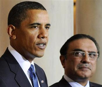 Pakistan's President Asif Ali Zardari looks on as U.S. President Barack Obama makes a statement to reporters at the White House in Washington, in this May 6, 2009 file photo. The killing of Osama bin Laden by U.S. forces was not a joint operation with Pakistan, the president of Pakistan said in an opinion column published on Monday. Zardari, writing in the Washington Post, also dismissed any notion that Pakistan was failing to take action against militants on its territory. The president said the whereabouts of the al Qaeda leader, killed in a town some two hours north of Islamabad, were not known to the Pakistani authorities.REUTERS/Jonathan Ernst/Files