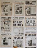 """<p>Передовицы американских газет, приклеенные к стене в отделе кадров Белого дома в Вашингтоне 2 мая 2011 года. Лидер экстремистской группировки """"аль-Каида"""" Усама бен Ладен убит в Пакистане американскими спецслужбами после 10 лет охоты за организатором самого громкого теракта в истории США 11 сентября 2001 года. REUTERS/Jason Reed</p>"""