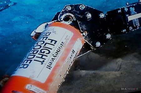 A mechanical arm, seen in this image published on the web site of France's BEA air accident inquiry office May 1, 2011, holds an orange cylindrical flight data recorder above the sand. REUTERS/BEA/Johann Peschel/HO