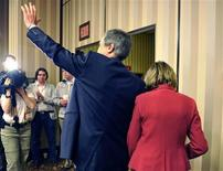<p>Liberal Party leader Michael Ignatieff waves as he and his wife Zsuszanna Zsohar leave after announcing his resignation as Liberal leader during a news conference in Toronto, May 3, 2011. REUTERS/Mike Cassese</p>