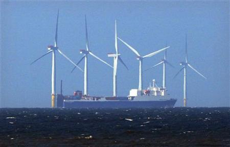 A ship sails past the Barrow offshore 90 megawatt wind farm, developed by British and Danish energy groups Centrica and DONG Energy, off the coast of Cumbria, England April 12, 2011. REUTERS/David Moir