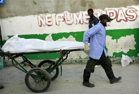 A dead body is transported from the cholera pavilion at a general hospital Port-au-Prince November 21, 2010. REUTERS/Kena Betancur