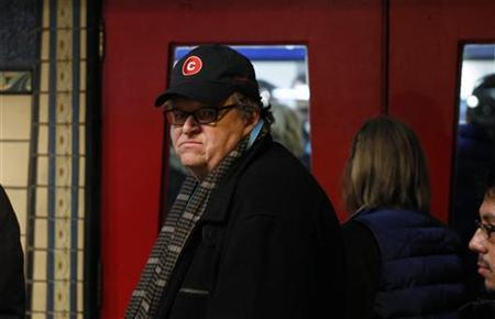 Director Michael Moore walks into a theater during the Sundance Film Festival in Park City, Utah January 20, 2011. REUTERS/Lucas Jackson