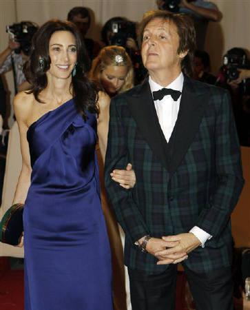 Nancy Shevell and Paul McCartney arrive at the Metropolitan Museum of Art Costume Institute Benefit celebrating the opening of Alexander McQueen: Savage Beauty, in New York, May 2, 2011. REUTERS/Mike Segar