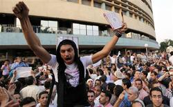"<p>A man carries a Koran and a cross during a demonstration by Egyptian Christians and Muslims shouting ""Muslims and Christians hand in hand"" in front of the Egyptian Television building in downtown Cairo May 8, 2011. REUTERS/Amr Abdallah Dalsh</p>"