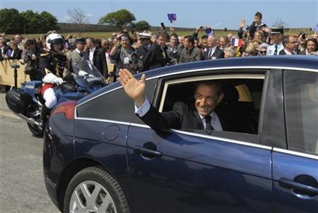 France's President Nicolas Sarkozy waves to bystanders as he leaves the citadel of Port-Louis, western France, following armistice ceremonies commemorating the end of World War II, May 8, 2011. REUTERS/Philippe Wojazer