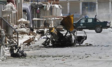 Debris from a car bomb is seen on a road in Kandahar city May 8, 2011. REUTERS/ Ahmad Nadeem