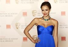 <p>U.S. actress Jessica Alba poses for photographers at the British Film and Television Arts (BAFTA) award ceremony at the Royal Opera House in London February 13, 2011. REUTERS/Luke MacGregor</p>
