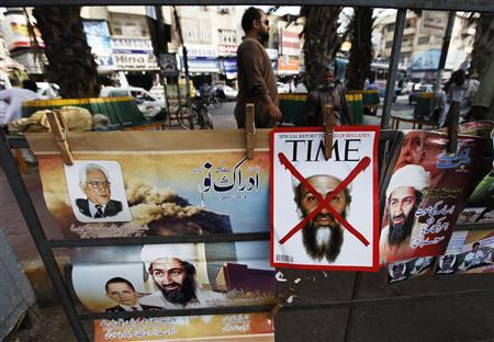 A newspaper stand displays magazines and posters bearing the pictures of al Qaeda leader Osama bin Laden and U.S. President Barack Obama (bottom L) in Karachi May 9, 2011. REUTERS/Athar Hussain