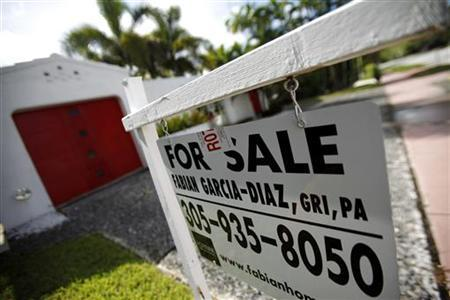 A for sale sign sits outside of a house in Miami Beach October 22, 2009. REUTERS/Carlos Barria