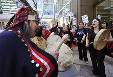 <p>First nations natives from British Columbia protest in front of the headquarters of Enbridge before the company's annual general meeting in Calgary, Alberta, May 11, 2011. The natives are protesting an oil pipeline that will go through their land. REUTERS/Todd Korol</p>