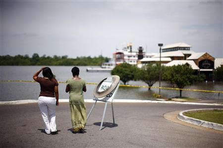 People look at the rising Mississippi River near a partially submerged casino in Greenville, Mississippi, May 11, 2011. REUTERS/Eric Thayer