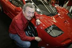<p>Pink Floyd drummer Nick Mason poses for photographers next to his 1995 Mac Laren F1 GTR displayed at the Retromobile car show in Paris February 16, 2007. REUTERS/ Benoit Tessier</p>