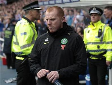 Celtic manager Neil Lennon walks out into the stadium before their Scottish Premier League 'Old Firm' match against Rangers at Ibrox Stadium in Glasgow, Scotland April 24, 2011. REUTERS/David Moir